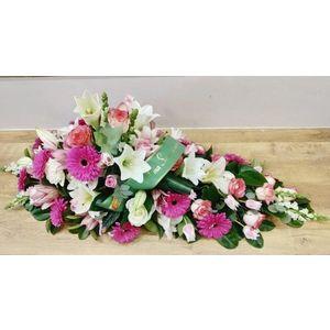 Dessus de cercueil rose et blanc